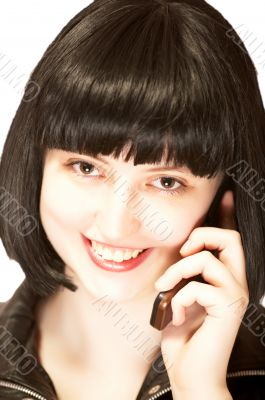 Young beautiful brunette talking to mobile phone