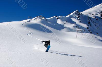 snowboarder ride in powder