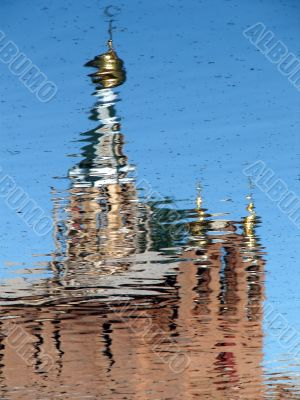 Church Cupola reflected in wavy water