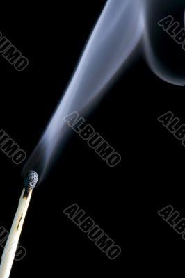 match with smoke closeup