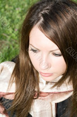 Portrait of the nice girl on green background