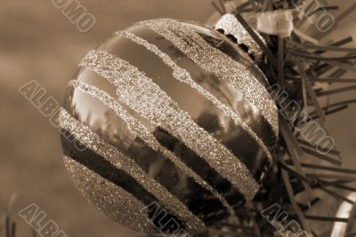 Christmas Decoration Textured Red and Silver Bauble sepia