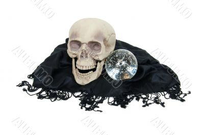 Crystal ball and skull on shawl