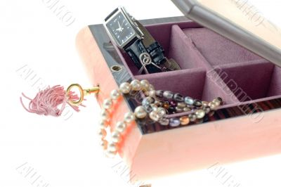 pearl necklaces and watch in open encrusted box