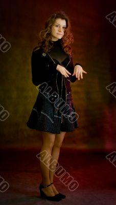 Beauty girl in black on dark background