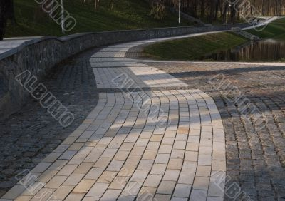 Brick wide road  through the park