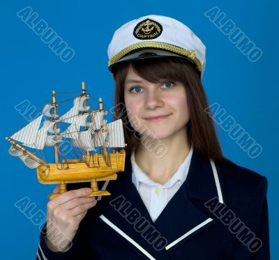 Woman with uniform cap and the ship