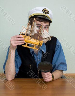 Man in uniform cap with sailer