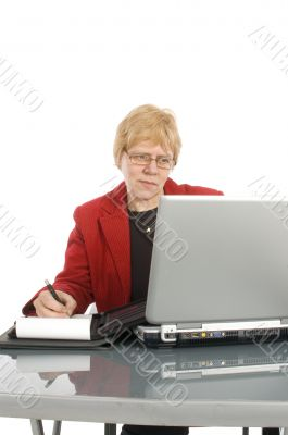 succesfull businesswoman is looking at her finance stats with a