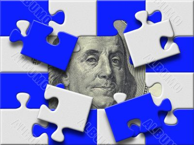 dollar banknote under missing pieses of blue and gray puzzle map