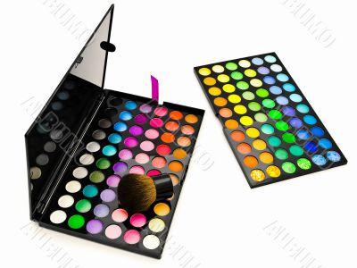 multicolored eye shadows and cosmetics brush