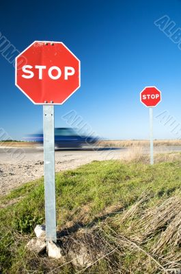 fast car with stop traffic signs