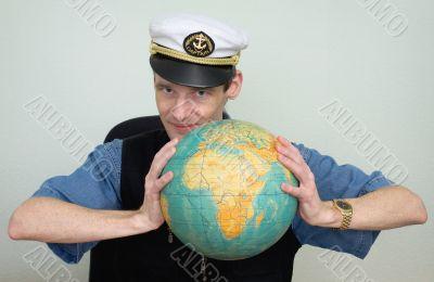 Guy in a sea uniform cap with globe