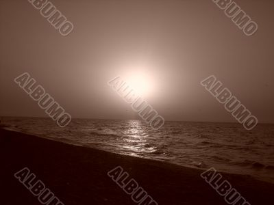 a sun is in a sepia