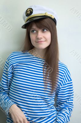 girl in stripped vest and a uniform cap