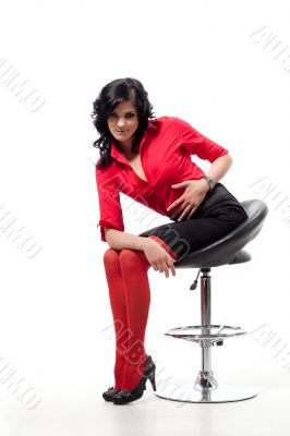 Beauty brunette poses on chair