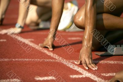 Focused Runner Positioned at Starting Block