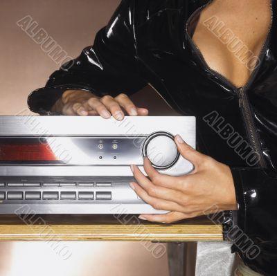 Woman  Turning Up Volume