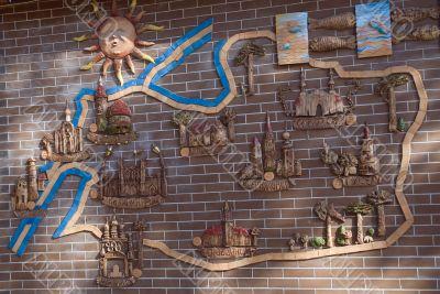 map at a wooden brick wall