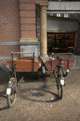 Two antique bicycle trailers