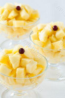 Closeup of three pineapple desserts