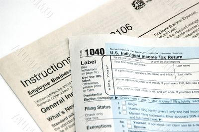 Hand signing a tax form concept of filing tax