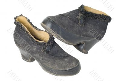 Old vintage traditional woman`s shoes isolated with clipping path.