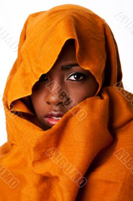 Mysterious female face in ocher head wrap