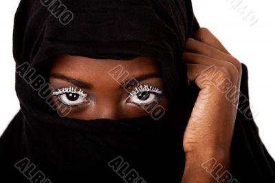 Female face in black scarf