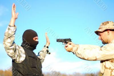 soldier aiming terrorist