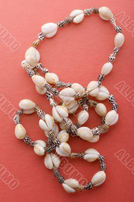 costume jewel beads on red