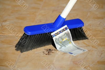 Five Euro Banknote and a Broom