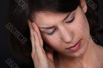 Closeup of a woman with a headache