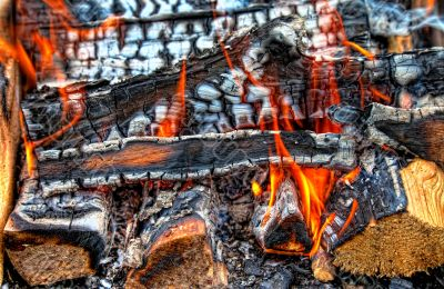 Closeup of a warm fire burning in a fireplace