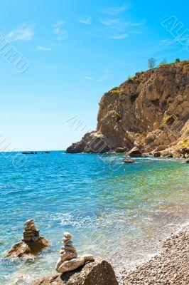 Bright view of calm wild beach of spanish coast line. Clean Medi