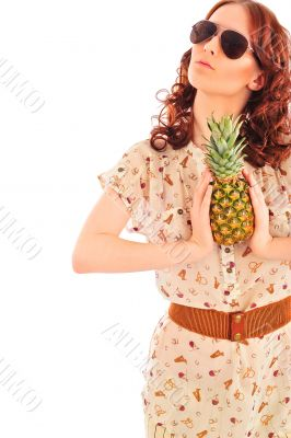 Closeup portrait of daydreaming woman holding pineapple fruit we