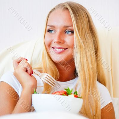 Closeup portrait of a beautiful slender girl eating healthy food