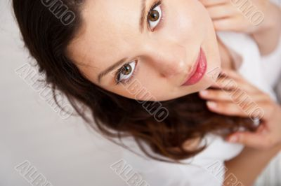 Portrait of a charming young lady relaxing on couch