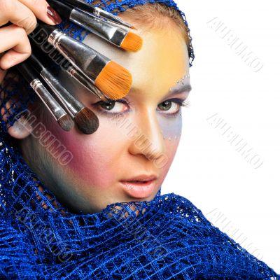 Portrait of a beautiful young women wearing a lot of makeup.