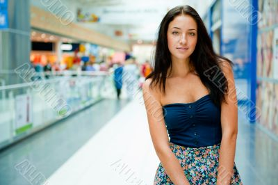 Portrait of beautiful excited relaxed young woman standing at th