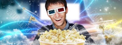 Portrait of young stylish modern man wearing 3d glasses watching