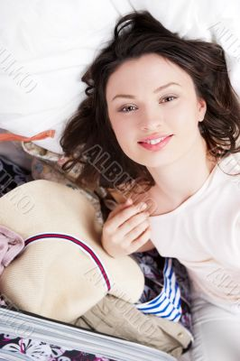 Portrait of young woman preparing for big trip and vacation she