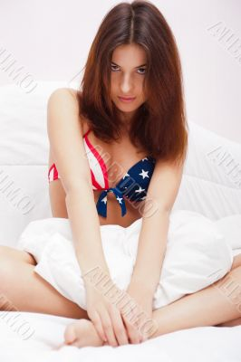 Fashion portrait of young elegant woman in bed wearing sexy unde