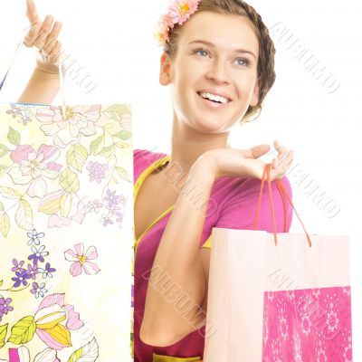 Portrait of lovely woman with shopping bags over white