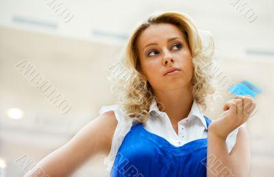 Beautiful shopping woman holding a credit card