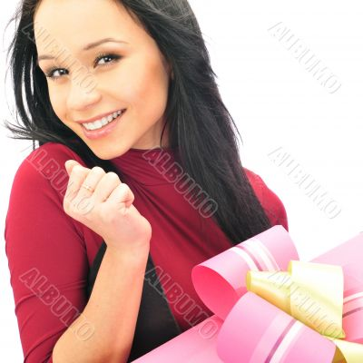 Beautiful European young woman holding her huge gift against whi