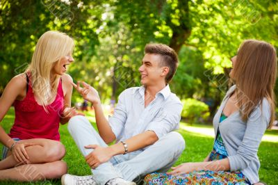 Portrait of three young teenagers laughing and having fun togeth