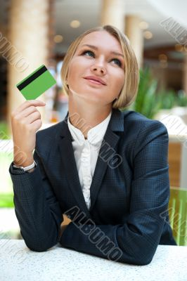 Closeup portrait of cute young business woman smiling while hold