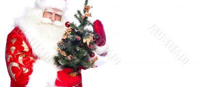 Christmas theme: Santa Claus holding christmas tree and his bag