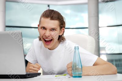 Portrait of handsome young man working with laptop on freelance
